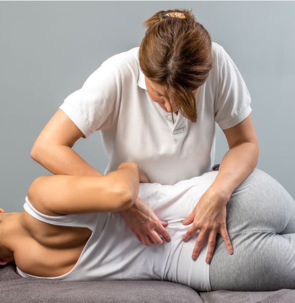Woman having a lower back massage