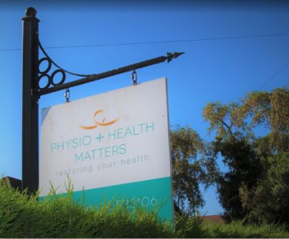 Sign for physio & health matters outside with the blue sky in the background