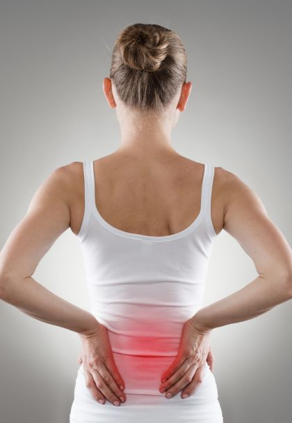 Woman's back showing pain radiating from her lower back